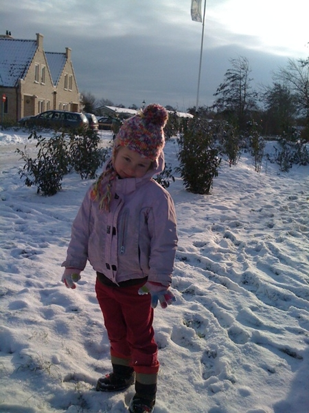Our little girl in the snow