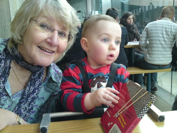 Reading his sushi book in wagamamas, with granny