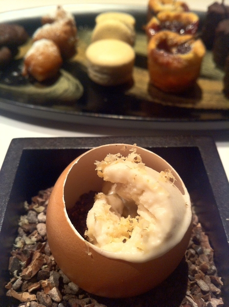 Manresa: post dessert: egg shell of banana mousse, cocoa nibb crunch, walnut ice milk, shaved walnuts.  Petit four.