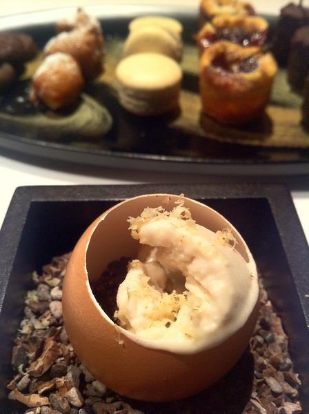 Manresa: post dessert: egg shell of banana mousse, cocoa nibb crunch, walnut ice milk, shaved walnuts.  Petit four.
