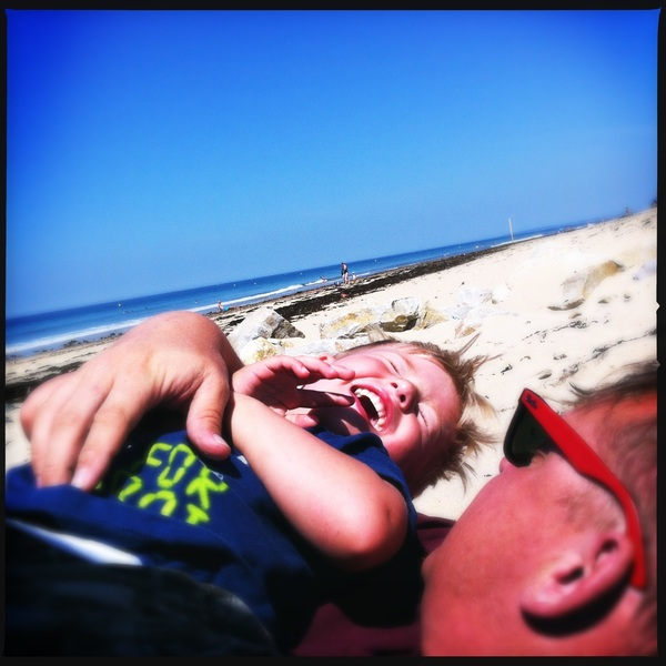Playing with papa on the beach