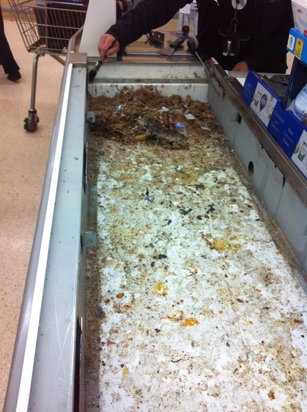 Tesco checkout being cleaned today. Under the conveyer belt. Disgusting! Was told off for taking this pic. Please RT!