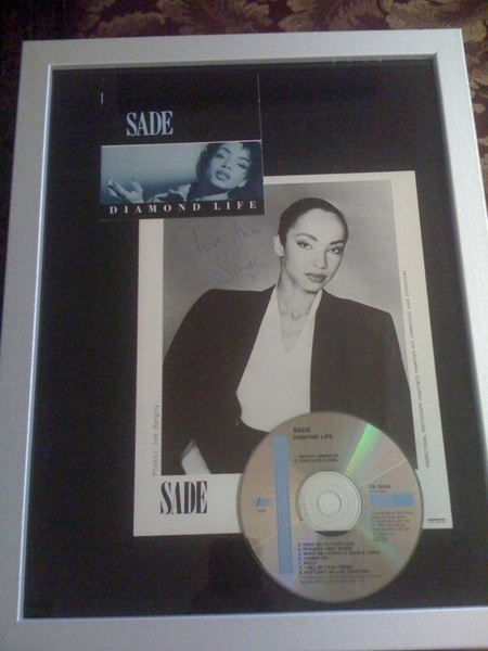 Check out my autographed Sade cd/photo I got for my birthday. Love this lady!