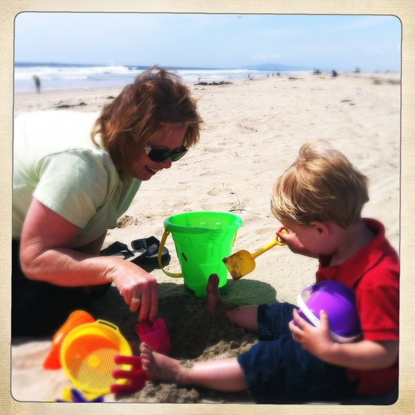 Fletcher of the day: building a sandcastle with Auntie Connie
