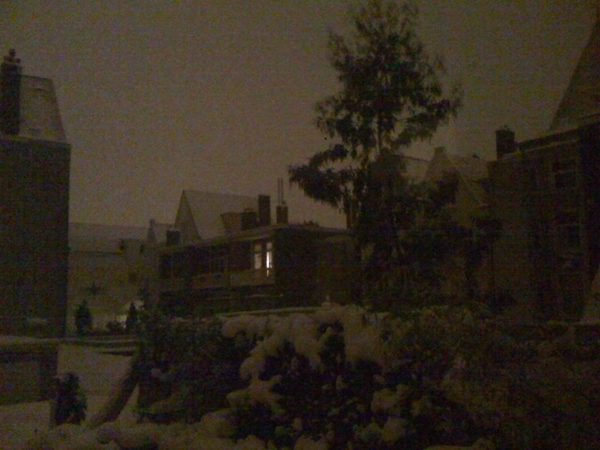 01.30 am; the snow reflects the city light