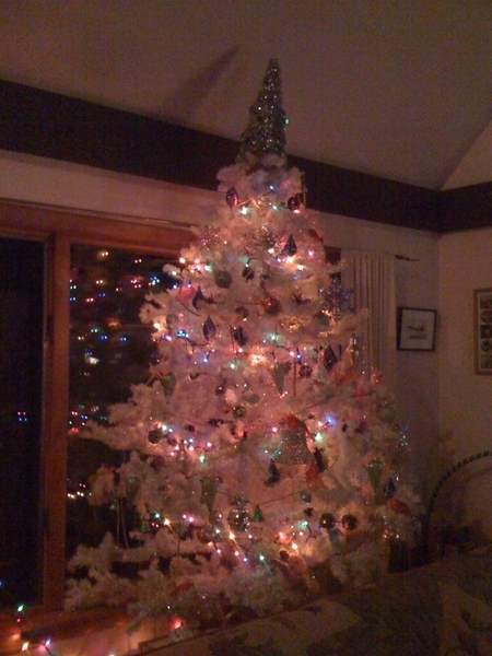 Tacky Tree After Dark! In other news, Mr. W appears to be bleeding & the cat appears very pleased with himself #fb