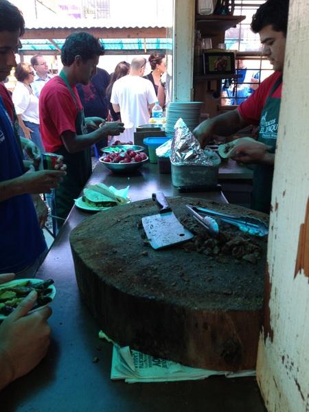 Los Perrones/El Yaqui: Making big carne asada tacos on handmade flour tortillas w chs, beans, salsa, guac