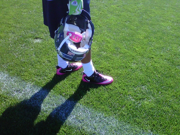 Earl Thomas breaking in his pink cleats & pink chinstrap in anticipation of Sunday's game