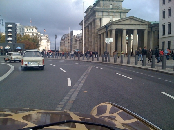 Crossing former wall at Brandenburger Tor in our Trabi