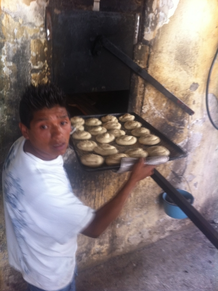 Puebla artisanal Pan Coty: Don Celestino's son sliding cemitas into 60 yo diesel-fired oven