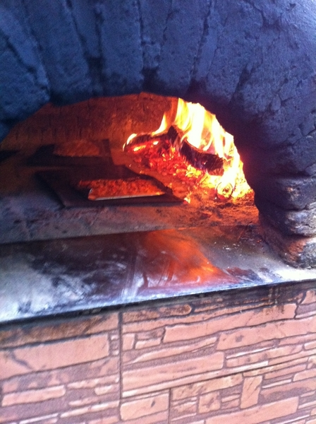 Lunch at Marco Polo: my fish cooking in the woodburning oven